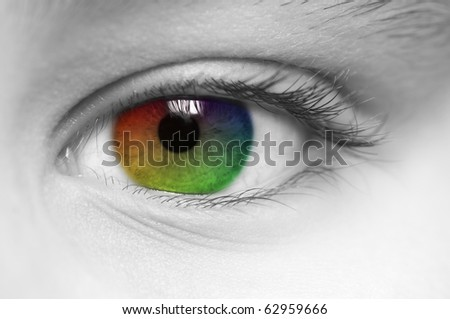 Macro of child's eye with rainbow colors - stock photo