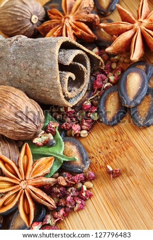 Macro of Cinnamon, Sichuan Pepper, Star Anise and other Assorted Spices used in Asian Cooking - stock photo