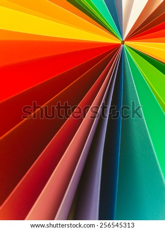 macro of colorful origami paper with different shades arranged in fan shape. abstract background - stock photo