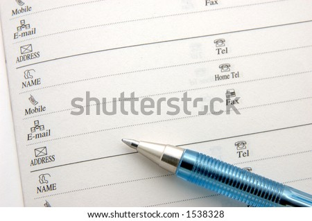Macro of contact information and pen - stock photo