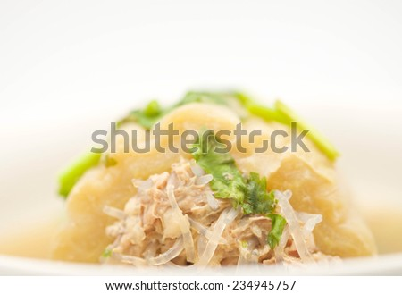 Macro of delicious bitter gourd with pork meat pudding soup on white background - stock photo