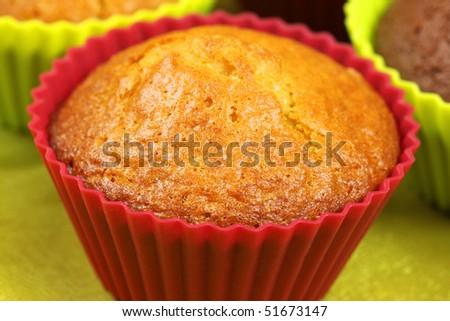 Macro of lemon cupcake in red silicione mold - stock photo
