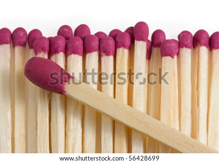 Macro of matches and big one over them, leadership teamwork concept - stock photo