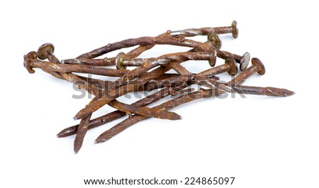 Macro of pile of rusty nails isolated against white - stock photo