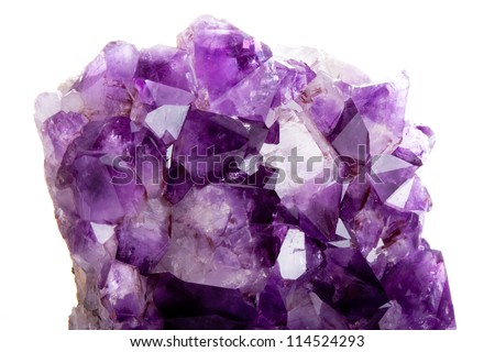 Macro of purple amethyst against a white background. - stock photo