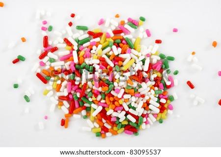 macro of rainbow sprinkles - stock photo