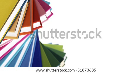 Macro of twisted stack of colorful real books on white background. - stock photo