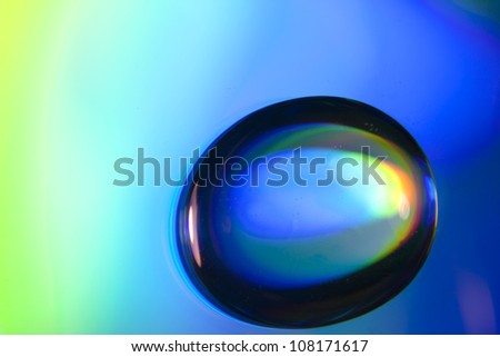 Macro of water drops on colorful background - stock photo
