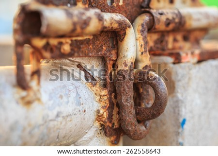 Macro old and rusty metal latch - stock photo