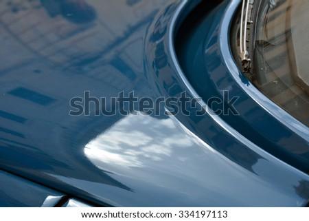Macro on blue shining car hood. - stock photo
