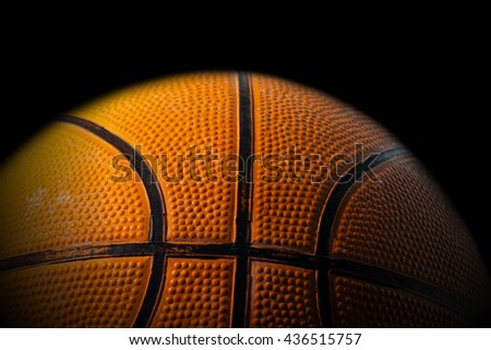 Macro photo of an old black and orange basketball with shadows - stock photo