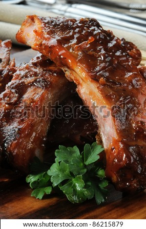 Macro photo of baby back ribs with barbecue sauce - stock photo