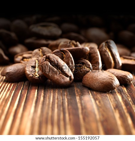 macro photo of coffee and brown desk  - stock photo