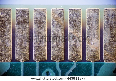 macro photo of golden plates electronic components on the printed circuit board pcb - stock photo