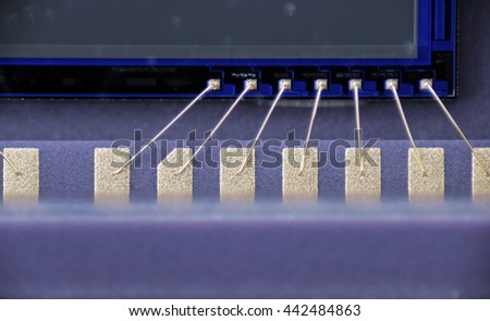Macro photo of micro gold contacts are connecting matrix with PCB board - stock photo