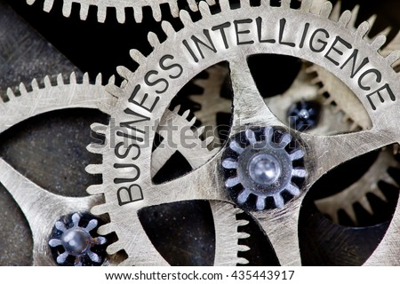Macro photo of tooth wheel mechanism with BUSINESS INTELLIGENCE concept letters - stock photo
