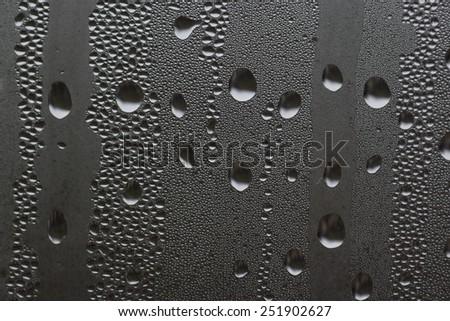 macro photo of water drops on a window glass - stock photo