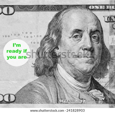"""Macro portrait of Benjamin Franklin from hundred-dollar U.S. bill with word balloon: """"I'm ready if you are"""" (in black and white, except for green text; some identifiers have been removed) - stock photo"""