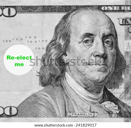 "Macro portrait of Benjamin Franklin from hundred-dollar U.S. bill with word balloon: ""Re-elect me"" (in black and white, except for green text; some identifiers have been removed) - stock photo"