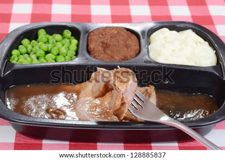 Macro roast beef tv dinner on fork - stock photo
