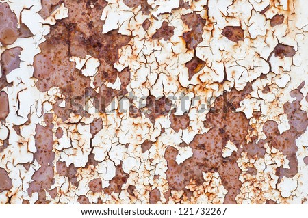 Macro rust .Grunge background painted metal surface is covered with rust and cracked paint - stock photo