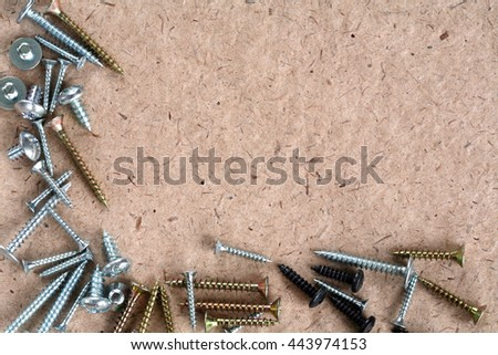 macro screw set on white paper, layout - stock photo