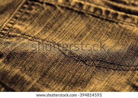 Macro shoot of jeans, sepia tone, selective focus - stock photo