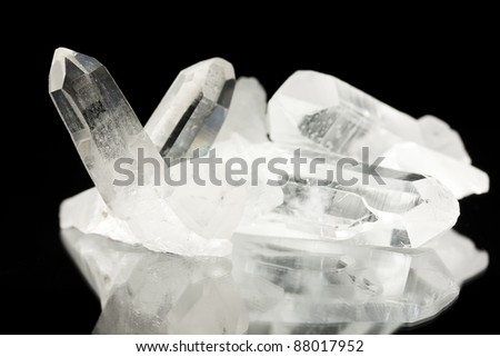 Macro shoot of Quartz crystals on black. See my portfolio for more - stock photo