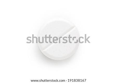 Macro shoot of single white pill isolated on white background. - stock photo