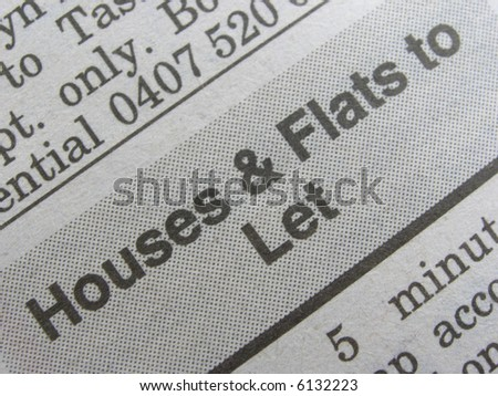 Macro shot newspaper classified section for home hunters. - stock photo