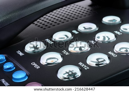 Macro shot of a black phone showing the dialing pad - stock photo