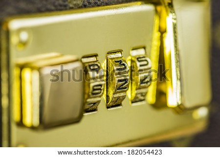 macro shot of a combination lock of a suitcase. shallow depth of field - stock photo