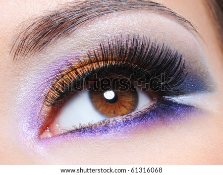 Macro shot of a female eye with fashion saturated make-up - stock photo