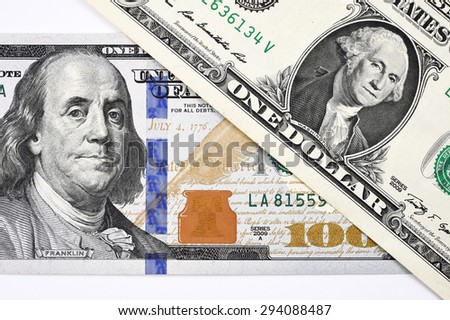 Macro shot of a new 100 dollar bill and one dollar isolate on white background - stock photo