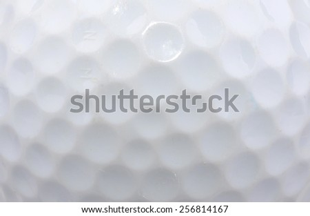 Macro shot of a used golf ball - stock photo