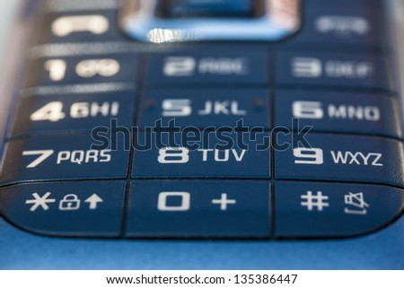 macro shot of an obsolete and blue mobile phone keypad - stock photo