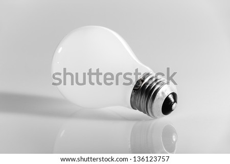 macro shot of an obsolete incandescence light bulb over a white background - stock photo