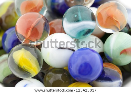 Macro shot of assorted marbles in various colors and designs - stock photo