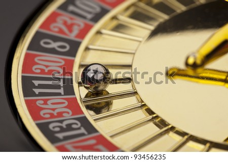 Macro shot of beautiful golden roulette on a black background. - stock photo