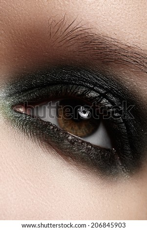 Macro shot of beautiful woman's face part. Wellness, cosmetics and make-up. - stock photo