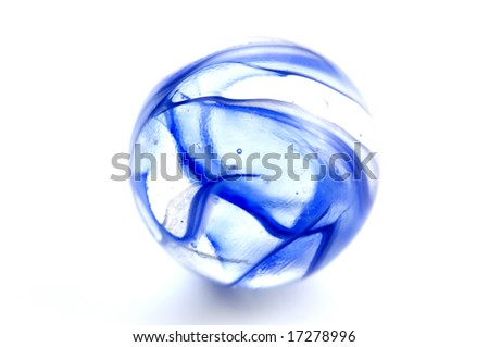 Macro shot of blue marbles on white background - stock photo