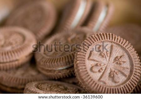 macro shot of chocolate cookies on a plate, macro, shallow DOF - stock photo