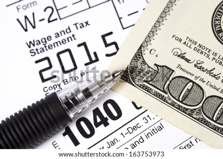 Macro shot of documents required to file a US tax return. - stock photo