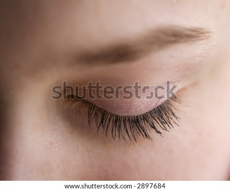 Macro shot of eyelashes - stock photo