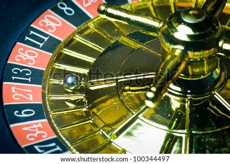 Macro shot of golden roulette - stock photo