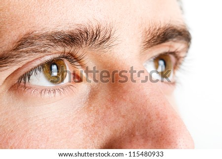 Macro shot of man's eye - stock photo