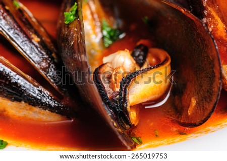 Macro shot of mussels prepared in italian rustic style with wine and parsley - stock photo