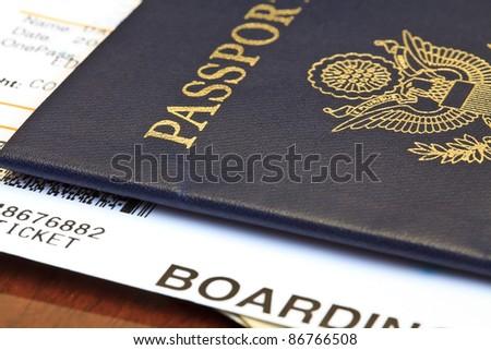 Macro shot of passport and boarding pass - stock photo