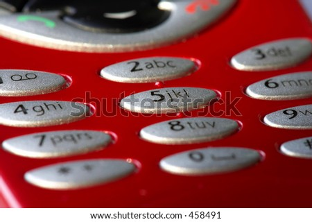 Macro shot of red mobile phone with number 5 focused, shallow depth of field - stock photo