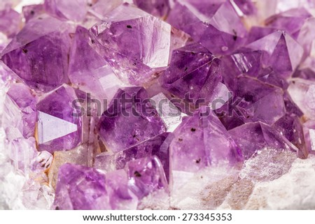 Macro shot of some vibrant edgy amethyst crystals - stock photo